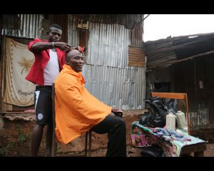 Hair cut in Kroo Bay web.jpg
